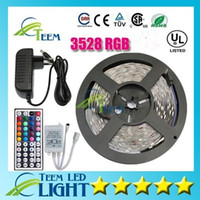 al por mayor rgb 12v-Impermeable RGB 3528 RGB CW WW Verde 5M 300 llevó la iluminación llevada luz tira impermeable 44 teclas IR control remoto + 12V 2A fuente de alimentación