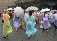 Wholesale 3000 DHL Free One time Raincoat Fashion Hot Disposable PE Raincoats Poncho Rainwear Travel Rain Coat Rain Wear Travel Rain Coat