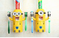 Wholesale Small yellow man automatic toothpaste dispenser Toothpaste shelf Home wash suit Sucker toothpaste device
