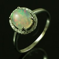 australian opal engagement ring - 2014 top grade Gem Natural Mined Multi Color Flash White Australian Genuine Fire Opal Oval X9mm Solid Sterling Silver Ring