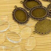Al por mayor-10set hace fuentes 25mm óvalo cabujones vendimia encanto joyas de estilo tibetano transparentes Borrar valores Cabochon de cristal