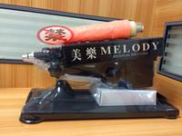 Máquina nueva pistola de oro Diseño del cañón de la ametralladora Masturbación Mujer de la ametralladora del juguete del sexo con un consolador de energía