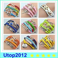 Wholesale 100pcs hot sale high quality fashion leather bracelets Mixed Infinity Silver weave wrap watch Style to