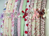 Wholesale Korean version of the pastoral small floral cotton cloth bag commoner frame wooden hanger sponge clothes child support