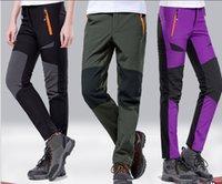 Wholesale Men and women shall catch Rongku thick warm wind rain soft shell climbing pants