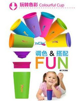 Wholesale Children s gifts WOW CUP colors FDA silicone degrees leakproof magic cup snack cup with color box