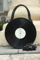 attracting men - new fashion Strange Attract eyeballs Japanese round CD album Model handbag