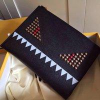 Wholesale Women fashion little monster Eyes Rivets calfskin wallet Ladies Luxury brand Clutch bag Luxury brand clutch bag