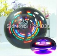 Wholesale New Christmas Gift UFO Shaped Colorful Flashy With Music Electric Spinning Top Light up Educational Toys