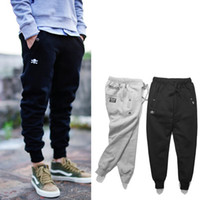 black pants - 2016 NHIZ MDNS Skull Beam Pockets Pants Men Cotton Fleece Thin Drawstring Loose Hip Hop Pants Skateboard Basketball Harem Pants