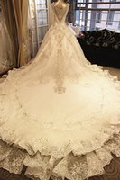 Wholesale Exquisite A Line Crystals Wedding Dresses Lace Appliques V Neck Real Images Cathedral Train Beading Bridal Gown