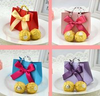 Cheap 50pcs Lovely Small Handle Bag Shape with Bowknot Pattern Elegant Pearl Paper Wedding Party Favors Gift Candy Boxes 9*5*7cm