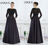 Wholesale Janique Prom Dresses New Cheap Jewel Neck Illusion Lace Appliqued Beads Back Satin Long Sleeves Party Dress Evening Gowns With Pocket