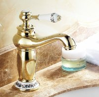 Wholesale and retail bathroom basin faucet gold finish brass mixer tap faucet hot and cold water torneira banheiro