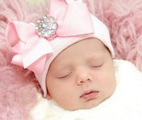 Wholesale Spring and autumn pink Big bow knit cap hedging lovely baby tire caps new born hats with rhinestone diamond