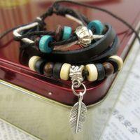 achat en gros de bois perle antique-12PCS / lots Tribal tissé main Plume d'argent Antique Perles Pendentif bois chanvre cordon en cuir Bracelet Wristband réglable