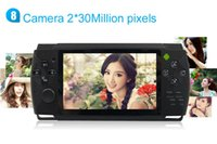 Wholesale C4305 quot Android handheld game console player with dual cameras WIFI MP3 MP4 and D games multiplayer