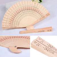 antique ladies fans - 100pcs Ladies Handmade Folding Wooden Hand fans Hollow Flower Engraving Sandalwood Fans Dancing Accessories H137