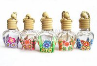 Cheap Wholesale 100pcs 8ml Hanging Car Perfume Bottle Glass Pendant Essence Oil Bottle with Wooden Cork Rope Jewelry Perfume Bottle