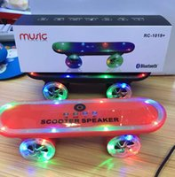 Wholesale 2015 Christmas Gift LED Flash Kick scooters Mini bluetooth speakers wireless Subwoofer Stereo Portable Skateboard speaker for Table pc phone