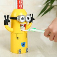 Wholesale 2015 Cartoon Small yellow man automatic toothpaste dispenser Toothpaste shelf Home wash suit Sucker toothpaste device