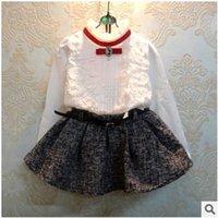 Mejor Venta 2 Pcs Niñas Establece cordón de la muchacha linda camisetas con faldas Juegos para niños otoño Equipos 2015 Moda nueva llegada Trajes para niños