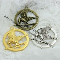 antique game pieces - pieces mm Antique Bronze Plated Metal Alloy Hunger Games Charms Jewelry Pendant Charms D0469
