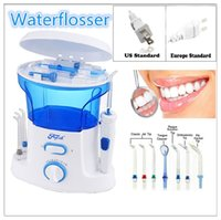 Wholesale Top quality portable and rechargeable water flosser family use oral care products Dental Cleaning teeth Water Tank and Tips Five Color