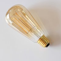 Liderados filamentos Bulbos ST64 Amber Tinte largos filamentos de Dimmable 4W 6W jaula de ardilla antiguo Edison Iluminación E27 B22 E26 Blanco cálido Bulbos Retro