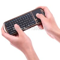 Wholesale Russian Version Air Mouse Ipazzport g Mini Handheld Wireless Keyboards with Ir Remote Laser Pointer
