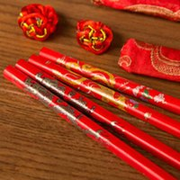 Wholesale Traditional Chinese Wooden Printed Chopsticks Wedding Favors With Silk Pouch Pair