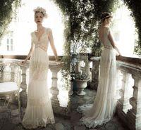 beach fabric - Elegant new arival sheath wedding dresses lace fabric sexy backless V neck sweep train beach A line Empire bridal gowns BO6780