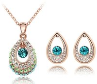 aqua jewellery - teardrop crystal gold jewellery set