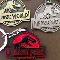 Wholesale Promotion gift Jurassic Park keychain luxury alloy dinosaur key chains key rings badge pendants movie jewelry cardboard packaging