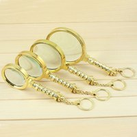 Wholesale 60 mm X X X X Golden Handheld Magnifier Loupe with Key Ring Portable Magnifying Glass Reading Tool lupas de aumento