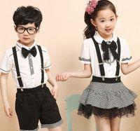school clothes - School Uniform Childre Uniforms Summer Korean Boys Girls Clothes Performance Costumes White Shirts Shorts Pants Lace Check Skirts I3093