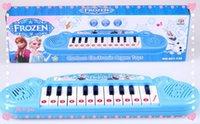 al por mayor musical toy organ-Nuevo juguete instrumentos musicales para los niños Muchacha congelada Cartoon órgano electrónico de teclado de piano de juguete bebé electrónica con música 8 canciones DHL 100