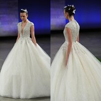 Cheap 2016 Sparkly Wedding Dresses Arabic Ball Gown Deep Plunging V Neck Cap Sleeves Bridal Gowns with Sequins Beads Top Shinny Tulle Formal Gowns