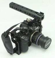 Precio de Aparejo de jaula-Jaula libre de la cámara del envío DSLR con el apretón superior de la manija para el aparejo Panasonic Lumix GH3 GH4 de la cámara