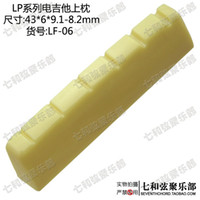 Wholesale Faint yellow plastics MM electric guitar violin nut upper violin bridge front string nut upper string bridge