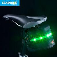 Wholesale Riding bicycle saddle bag impression luminous tail LED warning lamp waterproof bag bag bag recoil bicycle saddle