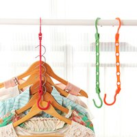 Wholesale Coatless hangers windproof rings racks fashion clothes rack simple magic clothes hanging pieced per pack