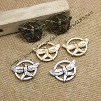 antique game pieces - pieces mm Three color Plated Antique Metal Alloy The Hunger Game Charms Fit Jewelry Making Charms T0212