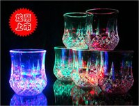 Wholesale The new Christmas magic pineapple cup water induction luminous glass beer mug led flash glass into colorful shiny OZ ml