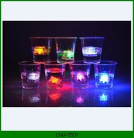 Wholesale Colorful Led Ice Cube water actived Light up Flash light colors Auto Changing Crystal Cube for wedding party Bar
