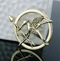 Wholesale The Hunger Games Brooches Inspired Mocking jay And Arrow Brooches Pin Corsage Promotion New Arrival European Hot Movie For Women And Men