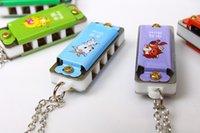 Wholesale Scenic hot mini four hole Siyin harmonica musical toys children cartoon Keychain small harmonica