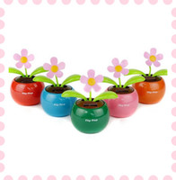 Wholesale Home Car Flowerpot Solar Power Flip Flap Flower Plant Swing Auto Dance Toy