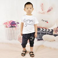 Cheap Baby Girls And Boys Cartoon Clothes Set Small Calico Short Sleeves T Shirt+Pants 2015 New Summer Kids Suits 2102056