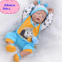 Cheap 22inch Full Silicone Reborn Baby Boy Dolls Of NPK Brand With Closed Eyes Very Lovely Vinyl Baby Dolls Toy Kids Gift Brinquedo